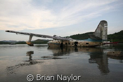 plane rotting on the surface crying out to be sunk as a d... by Brian Naylor 